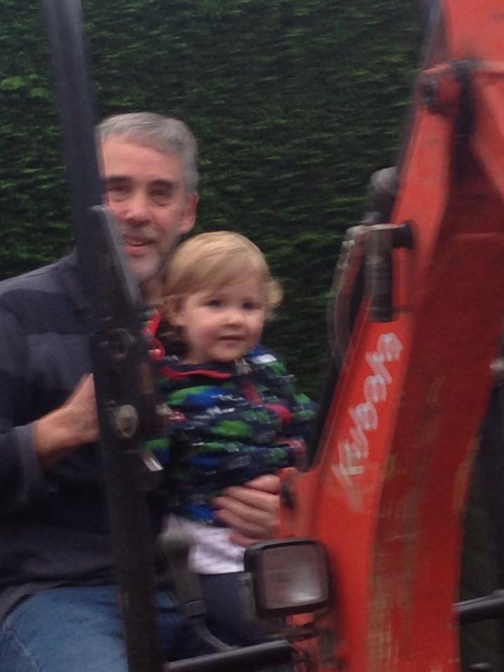 Mollie and grandad on digger.jpg